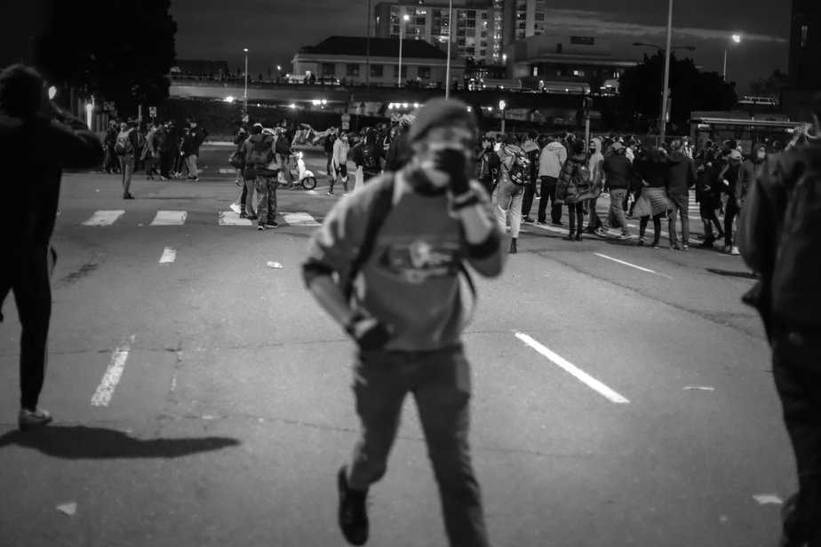 A protester holding their breath as they run by.