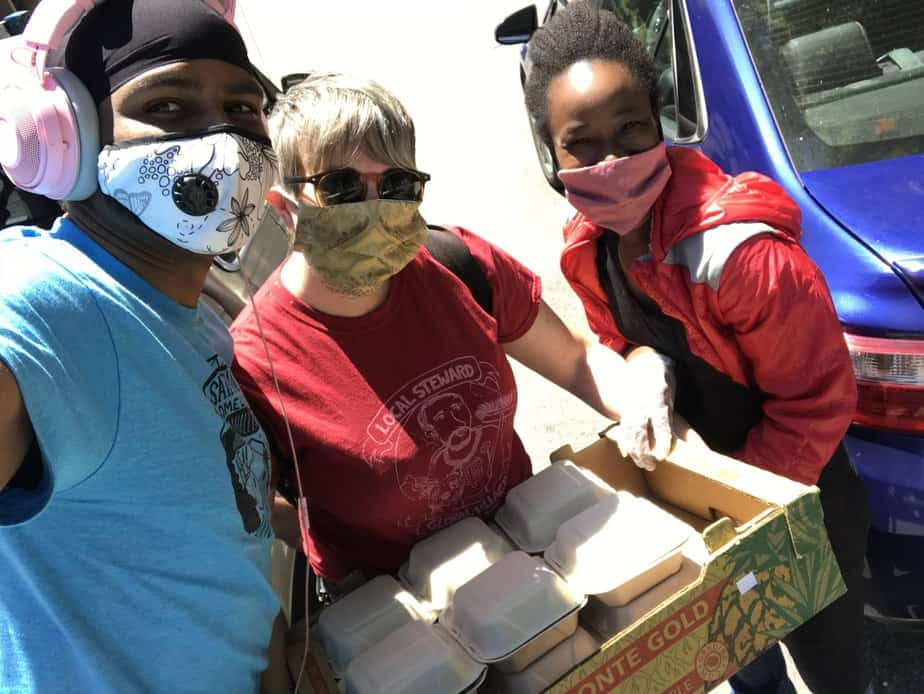 Flatley, far right, is joined by    Saint Francis Challenge    coordinators assisting with the delivery of meals to the homeless in San Francisco's Tenderloin District.