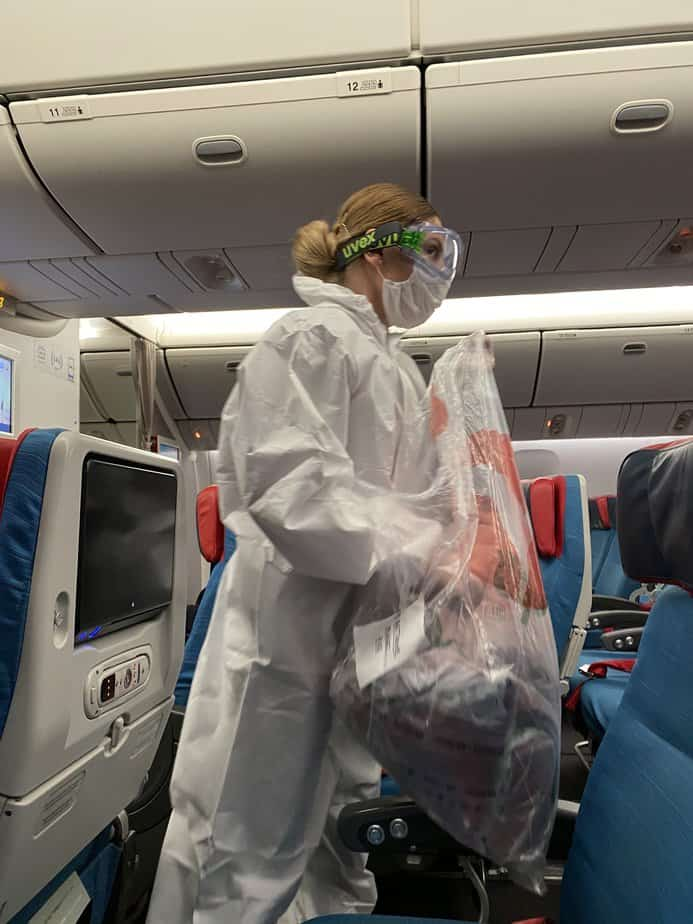 Turkish airline flight attendants taking precautious steps in the cabin. Wearing fully body PPE combined with gloves, masks, and eyewear.